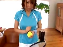 oriental beauty in tennis costume giving oral