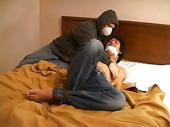 a bandit in mask fastened up an asian homosexual