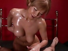 oiled up japanese hottie does titjob