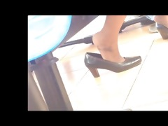 candid oriental shoeplay dipping feet in