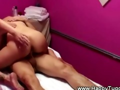 masseuse eagerly copulates her client on top of