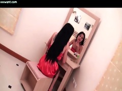 hot tgirl in red suit rubbing hard penis