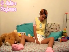 hawt gal masturbates in diaper and yellow onesie