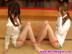 oriental babe gets stimulated by toys