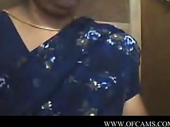 aged indian woman in saree on webcam uni