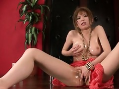 solo oriental cute playing with her large vibrator