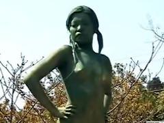 a living bare male japanese garden statue