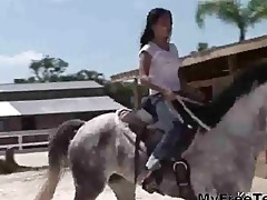 topless oriental legal age teenager riding a