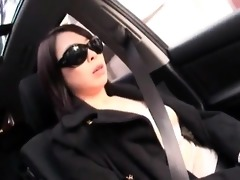 captivating oriental mother i sits in the car