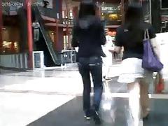 oriental hottie on the escalator