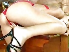oriental honey in shiny red outfit on boat1