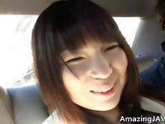 breasty oriental having pleasure in a car