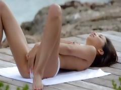 oriental girl posing by the ocean