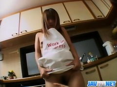 teen clad solely in apron drilled in the kitchen