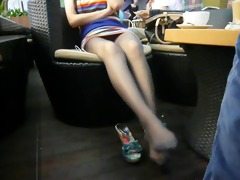 candid oriental feet in stockings at coffee shop